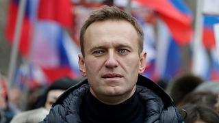 FILE - In this Sunday, Feb. 24, 2019 file photo, Russian opposition activist Alexei Navalny takes part in a march in memory of opposition leader Boris Nemtsov in Moscow.