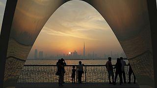 People enjoy a city skyline view with the World's tallest building Burj Khalifa, in Dubai, United Arab Emirates