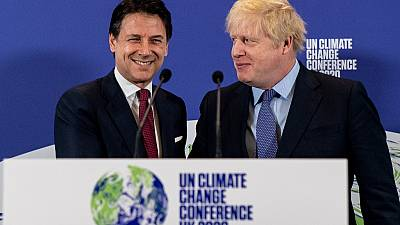 Britain's Prime Minister Boris Johnson (R) and Italy's Prime Minister Giuseppe Conte shakes hands during an event to launch the United Nations' Climate Change conference.