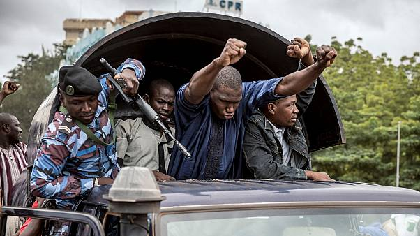 Security forces and others in celebration drive through the streets of the capital Bamako, Mali, Wednesday, Aug. 19, 2020