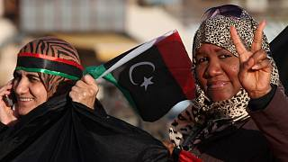 a Libyan woman flashes the victory sign at Tahrir Square, during the second anniversary of the uprising that toppled dictator Moammar Gadhafi in Benghazi, Libya, Feb 17, 2013