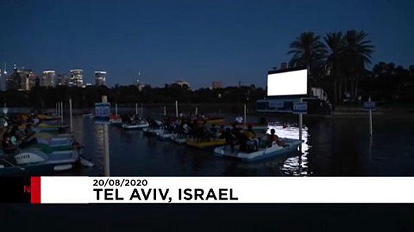 Moviegoers on boats in Tel Aviv's Hayarkon Park, Israel, August 20, 2020.
