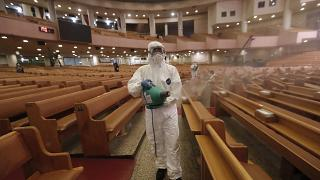 A public official disinfects as a precaution against the coronavirus at the Yoido Full Gospel Church in Seoul, South Korea, Friday, Aug. 21, 2020