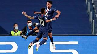 PSG's Marquinhos, right, celebrates with Neymar after scoring the opening goal during the Champions League semifinal VS Leipzig on August 18, 2020