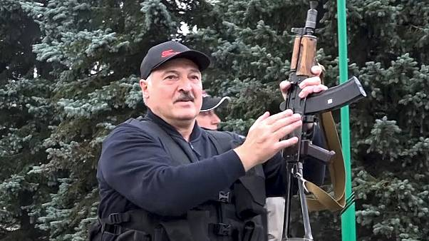 Video provided by state TV shows Belarus President Alexander Lukashenko armed with a Kalashnikov-type rifle on Sunday.