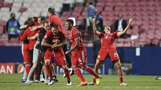 Bayern's Thomas Mueller, right, celebrates after winning the Champions League final soccer match between Paris Saint-Germain and Bayern Munich.