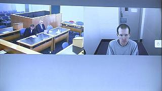 This image made from a video, shows Brenton Harrison Tarrant, right, and lawyers in a screen via video link in Christchurch, New Zealand, March 26, 2020.