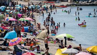 A packed beach at the beginning of a July heatwave in Marseille. The French health ministry has warned that COVID-19 transmission is increasing amid the summer holiday season.