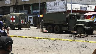 Soldiers recover bodies at the site of an explosion in the town of Jolo, Sulu province, southern Philippines on Monday Aug. 24, 2020.