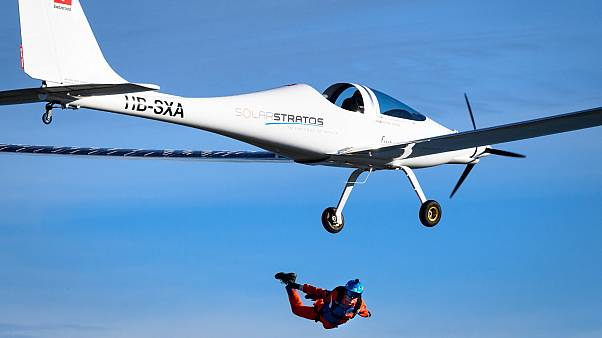 Swiss explorer 'first to complete parachute jump from solar-powered plane'