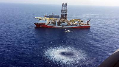 A helicopter flies over Turkey's drilling ship, 'Fatih' dispatched towards the eastern Mediterranean, near Cyprus.