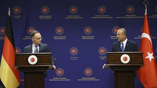 Turkey's Foreign Minister Mevlut Cavusoglu, right, and German counterpart Heiko Maas