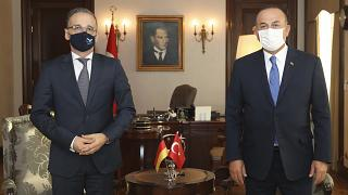 Turkey's Foreign Minister Mevlut Cavusoglu, right, and German counterpart Heiko Maas pose for photos before their talks, in Ankara, Turkey, Tuesday, Aug. 25, 2020.