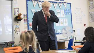 Britain's Prime Minister Boris Johnson visits The Discovery School in West Malling, England, Monday July 20, 2020