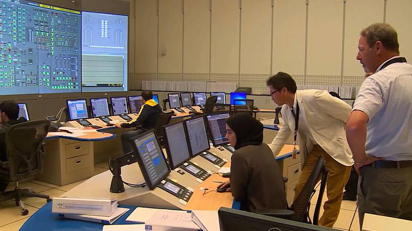 Employees monitor the Barakah plant