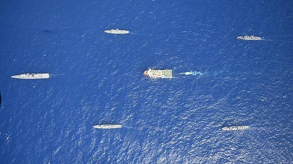 Turkey's research vessel, Oruc Reis, in red and white, is surrounded by Turkish navy vessels as it was heading in the west of Antalya on the Mediterranean