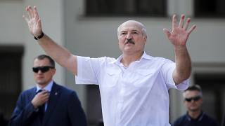 Belarusian President Alexander Lukashenko gestures as he greets supporters at Independence Square in Minsk, Belarus. August 16, 2020