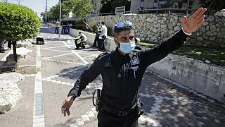 An Israeli police officer works at the site of a stabbing in the Israeli central city of Petah Tikvah, Wednesday, Aug. 26, 2020.