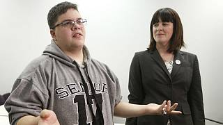 Gloucester County High School senior Gavin Grimm, a transgender student, left, speaks during a news conference as ACLU attorney Gail Deady