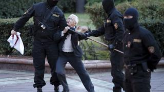 Opposition activist Nina Baginskaya, 73, struggles with police during a Belarusian opposition supporters' rally at Independence Square in Minsk, Belarus, Aug. 26, 2020.