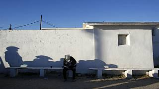 A man sat near south border of Phoenix with Mexico