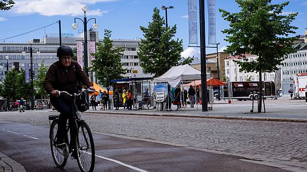 A cyclist rides past in Lathi, Finland, on August 24, 2020