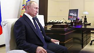 "Russian President Vladimir Putin listens for a question during his interview with Russian journalist Deputy General Director of the TV channel ""Russia"" Sergei Brilev."