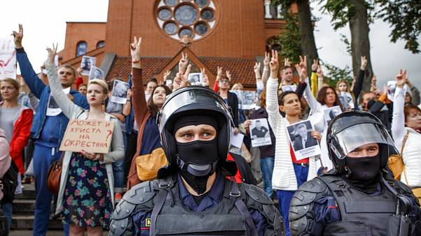 Riot police block protesters in front of a Catholic church in Minsk, Belarus.