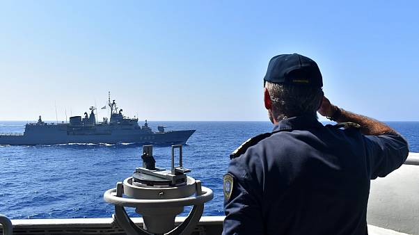 Photo provided by the Greek Defence Ministry, shows warships taking part in a military exercise in Eastern Mediterranean sea, Tuesday, Aug. 25, 2020.