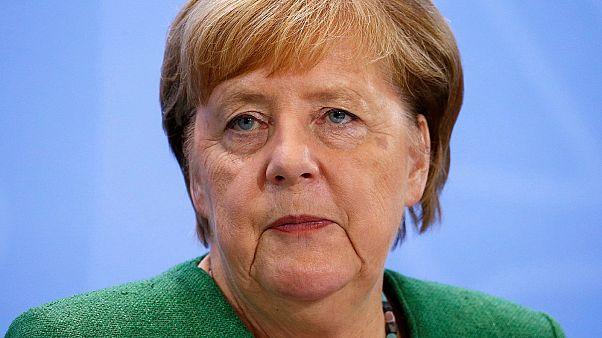 German Chancellor Angela Merkel addresses the media in Berlin on August 27, 2020