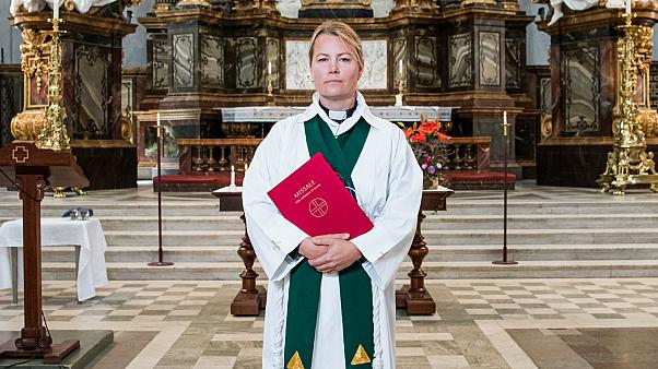 Priest Sandra Signarsdotter poses for a picture ahead of the Sunday service at Gustaf Vasa Church in Odenplan, Stockholm on August 23, 2020