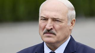 Belarusian President Alexander Lukashenko gestures while addressing employees of the Orsha dairy plant in Orsha, Belarus, Friday, Aug. 28, 2020