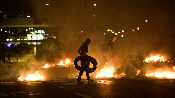 Demonstrators burn tyres during clashes with police in the Rosengard neighbourhood of Malmo, Sweden, on August 28, 2020