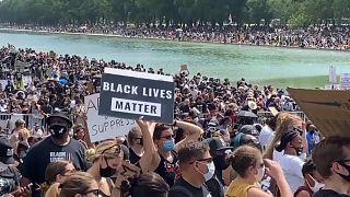 من التظاهرة أمس في واشنطن