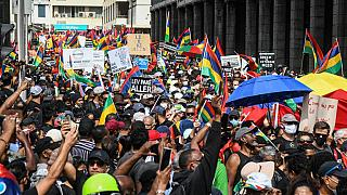 Thousands protest oil spill and government in Mauritius