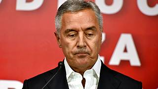 Montenegrin President Milo Djukanovic speaks at his DPS party headquarters in Podgorica, Montenegro, early Monday, August 31
