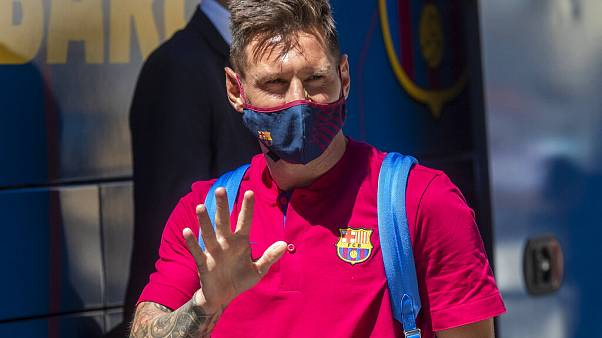 In this Aug. 13, 2020 file photo, Barcelona's Lionel Messi waves as he arrives at the team hotel in Lisbon, Portugal.