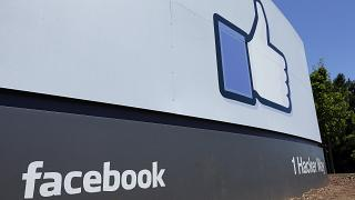 FILE - This July 16, 2013 file photo shows a sign at Facebook headquarters in Menlo Park, Calif.