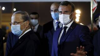 French President Emmanuel Macron, gestures before meeting with Lebanese President Michel Aoun, left, at Beirut International airport, Monday, Aug. 31, 2020