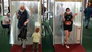 Passages equipped with disinfectant sprays at a shopping mall entrance in Moscow, Russia