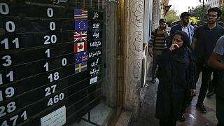 An exchange shop displays rates for various currencies, in downtown Tehran, Iran