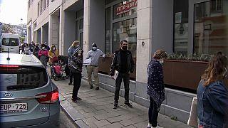 Belgium furloughed workers queue up at job centre, Brussels 2020.