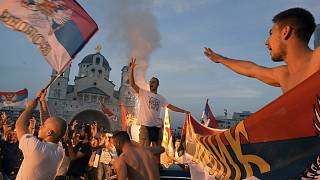 Opposition supporters celebrate the election results outside the Serbian Orthodox Church of Christ's Resurrection in Podgorica, Montenegro.