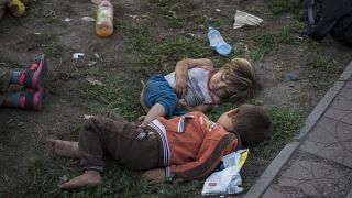 Syrian children sleep in a park in Belgrade, Serbia