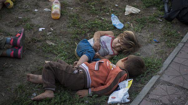 Syrian children sleep in a park in Belgrade, Serbia