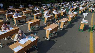 Uzbek students take open-air entrance exams in Tashkent.