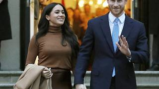 In this Jan. 7, 2020, file photo, Britain's Prince Harry and Meghan, Duchess of Sussex leave Canada House in London.
