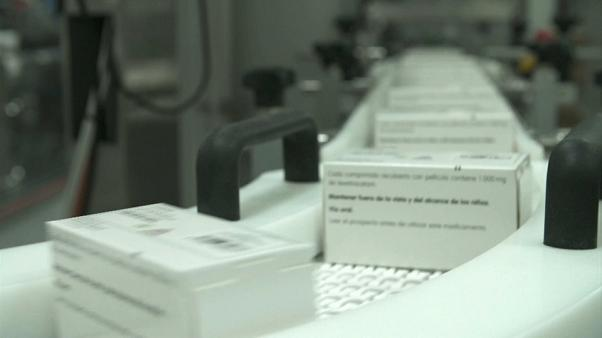 Medication labels are added on a production line before being shipped to European pharmacies.