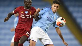 Liverpool's Sadio Mane and Manchester City's Rodri in action during a Premier League match in July.