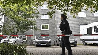 Police secure a house where five dead children were found in Solingen, Germany, Thursday, Sept. 3, 2020.